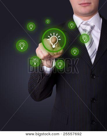 Man hand pressing light bulp icon poster