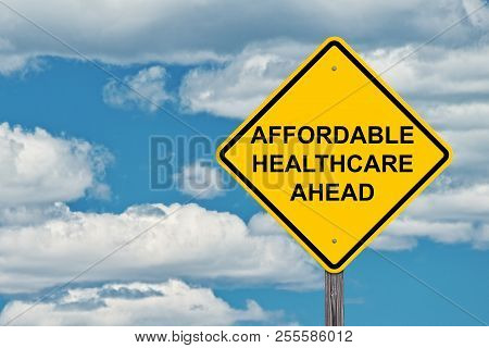 Affordable Healthcare Ahead Caution Sign Blue Sky Background