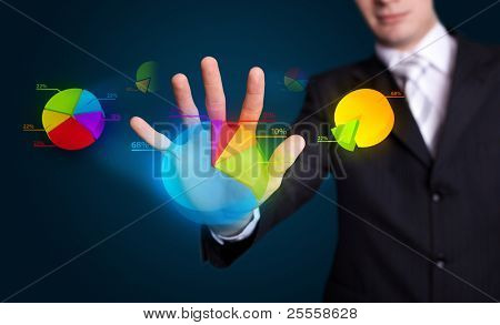 Businessman hand pressing pie chart button