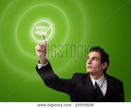"Business man pressing a ""Apply HERE"" button."