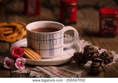 English Tea With Cookies On Wooden Rustic Table With Flowers And Cone. Concept Of Lovers Of English