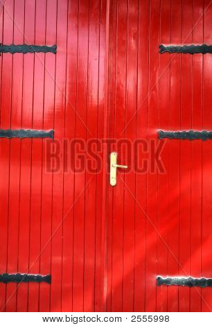 Red door with iron lock.Rural detail of city. poster