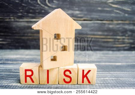 Wooden House And Cubes With The Word