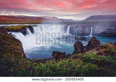 Colorful sunrise on Godafoss waterfall on Skjalfandafljot river, Iceland, Europe