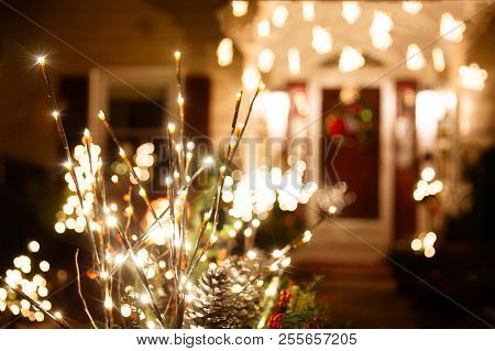 Shining Christmas Decorations Outside The House. Beautiful Glowing Christmas Composition Of Fir Bran