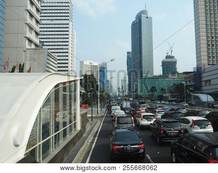 Jakarta, Indonesia - August 24, 2018: Traffic On Jalan Thamrin Around Hotel Indonesia Roundabout.