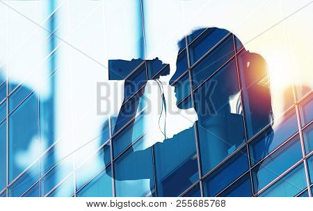 Businessman Looks For New Job Opportunities With Binoculars. Double Exposure