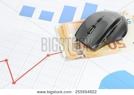 Computer Mouse And Euro Banknotes On Graphs, Make Money Online Concept