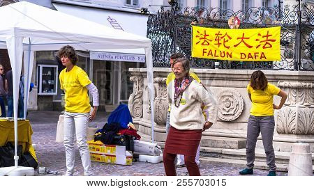 Salzburg, Austria - July 15, 2017: Unidentified Falun Dafa Members Demonstrate Traditional Chinese G