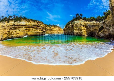 The Great Ocean Road of Australia. The concept of exotic, active and photo-tourism. Magnificent little beach in the bay of Pacific ocean