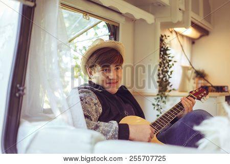 Young Traveler  In His Camper Van.