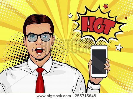 Attractive Smiling Man With Phone In The Hand In Comic Style. Pop Art Vector Illustration In Retro C