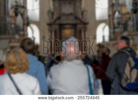 Blurred View Of Group Of Tourists In Baroque Cathedral Of The Roman Catholic Archdiocese
