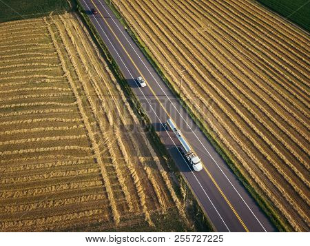 White Fuel Tanker Semi-truck 18 Wheeler Aerial View On Highway