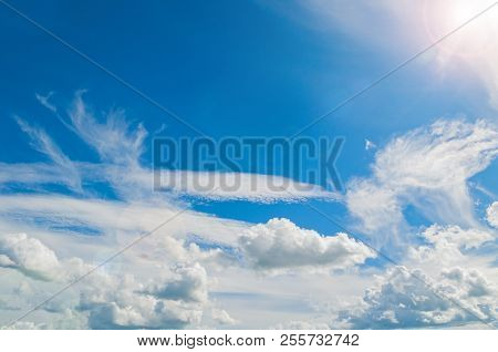Blue Sky Landscape View With White Dramatic Colorful Clouds And Soft Sunlight. Natural Sky Backgroun