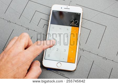 Paris, France - Sep 26, 2016: Male Hand Holding New Apple Iphone 7 8 Plus After Unboxing And Testing