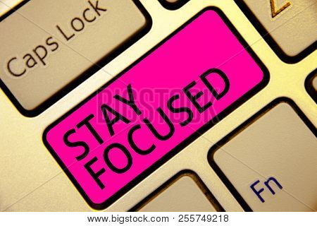 Text sign showing Stay Focused. Conceptual photo Be attentive Concentrate Prioritize the task Avoid distractions Keyboard pink key Intention create computer computing reflection document. poster