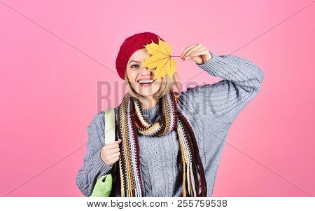 Autumn. Woman Hides Eye By Yellow Leaf. Yellow Maple Leaf. Autumn Leaves. Smiling Woman Holds Maple