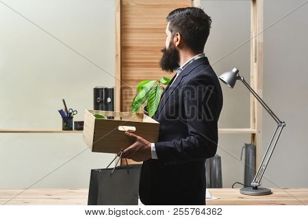 Office Worker In Office. Career. New Job. Businessman Holds Box With Office Things. Employee, Financ