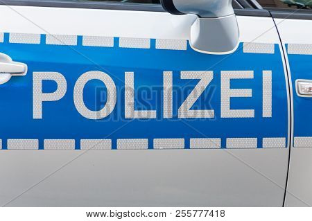 German Polizei Car Label Badge On The Patrol Car.