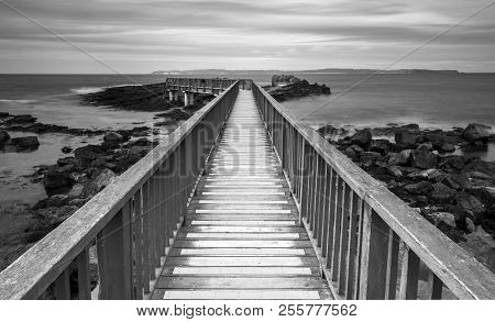 A View Across Pans Rocks Jetty In Black And White