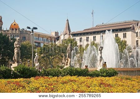 Barcelona, Spain - July 31, 2012: View Over Plaza Catalunya Fountain Sculptures And Hotel Barcelona