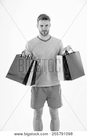 Man With Shopping Bags Isolated On White. Macho With Colorful Paper Bags. Fashion Shopper In Casual