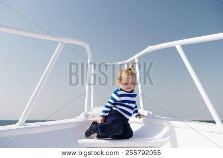 Around World. Child Cute Sailor On Yacht Sunny Day. Adventure Of Boy Sailor Travelling Sea. Boy Ador