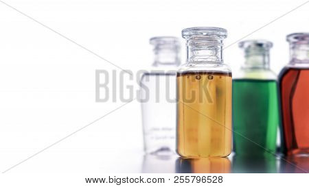 Small Colorful Plastic Bottles Of Shampoo, Liquid Soap Or Lotion For Traveling, Hotel Amenities Kit
