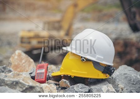 Safety Helmet (hard Hat) And Portable Radio Place On Construction Site (stone Quarry).equipment For