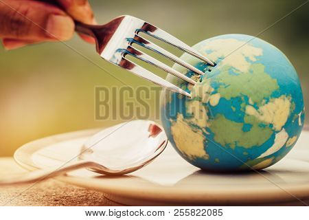 Fork Slammed On Globe Model Placed On Plate  For Serve Menu In Famous Hotel. International Cuisine I