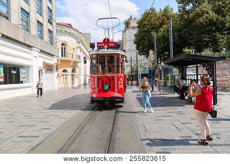 Istanbul, Turkey - August, 2018: Young Girls Tourists Making Photos Of Retro Tram On Istiklal Street