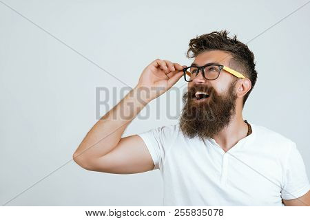 Handsome Young Man With Long Beard And Moustache With Happy Face In Glasses, So Shocked, Extremely H