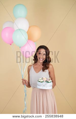 Happy Attractive Young Woman On Her Birthday Holding Cake And Ballons