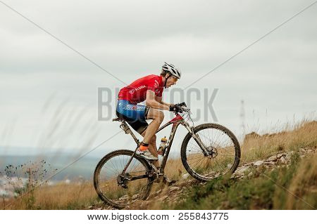 V.ufaley, Russia - August 12, 2018: Man Cyclist Mountain Biker Riding Uphill During Race Xcm Big Sto