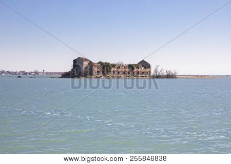 Small Island With Old Abandoned Decrepit Orange Brick House In The Lagoon Of Venice Near Burano, Ita