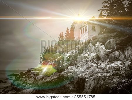 Bass Harbor Head Lighthouse in Maine with dramatic light flare effect