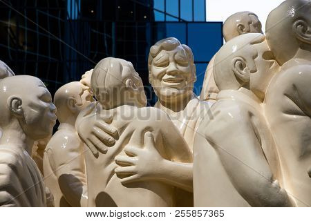 Montreal, Canada - 14th Sept2017: The Illuminated Crowd by Raymond Mason, stands outside the McGill University. It shows a group of people looking foward whilst behind them everything slips into chaos