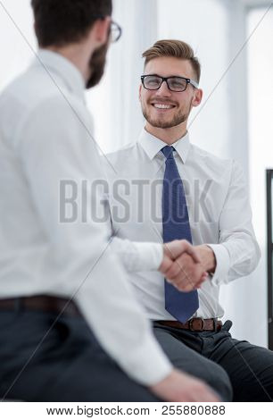 close up.business handshake of business people on a light background