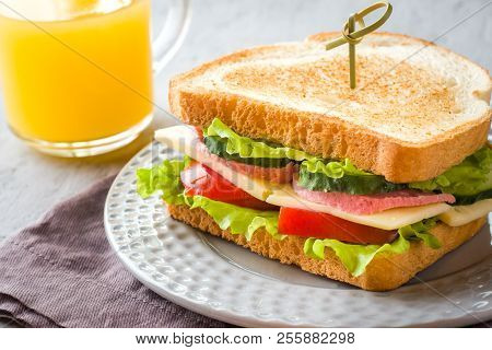 Sandwich With Cheese, Ham And Fresh Vegetables On A Plate. Fresh