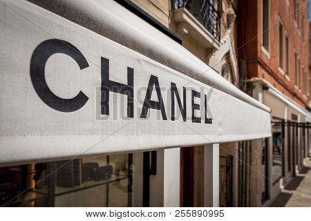 Venice, Italy - July 4, 2018: Chanel Brand Sign At Store Front. It Is A High Fashion House That Spec