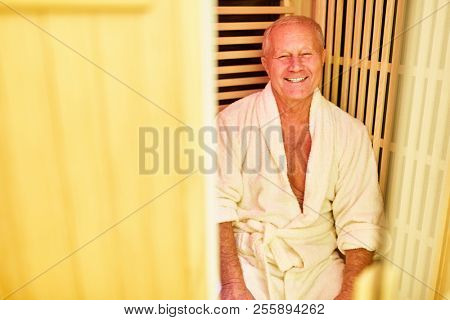 Happy senior relaxes in a sauna in senior residence or hotel