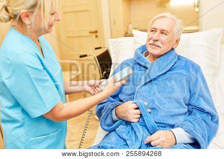 Nurse cares for a senior patient in the nursing home