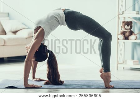 Young Sporty Woman Doing Gimnastic Exercises. Attractive Woman In Sportswear Doing Yoga Bridge Pose
