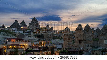 Evening View Of The Village Of Goreme In Cappadocia On The Background Of The Natural Terrain And The