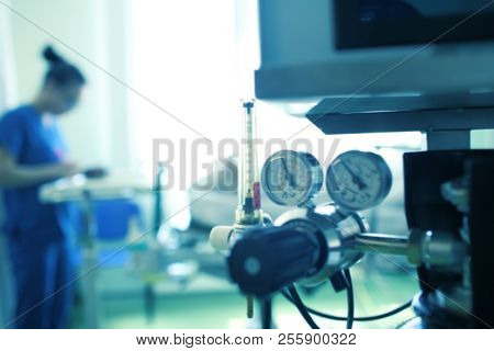 Blurred Silhouette Of A Female Medical Worker On The Background Of Gas Equipment, Unfocused Backgrou