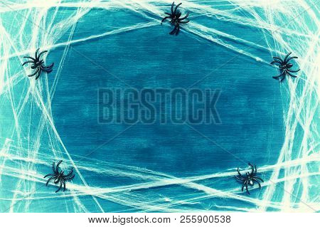 Halloween Background. Spider Web And Spiders As The Symbols Of Halloween On The Dark Green Wooden Ba