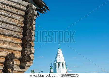 Wooden Walls Of An Ancient Fortress And Snow-white Walls Of A High Bell Tower.