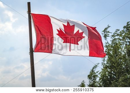 Canada Flag On A Flagstaff With The Flag Waving In The Wind