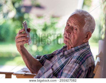 Old Man Talking On Mobile Phone